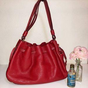 Kate Spade red pebbled leather drawstring tote bag